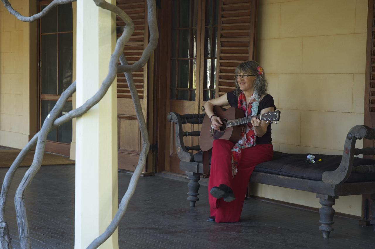 Juanita plays guitar